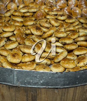 Chinese Bread heaped up in large wooden Barrel