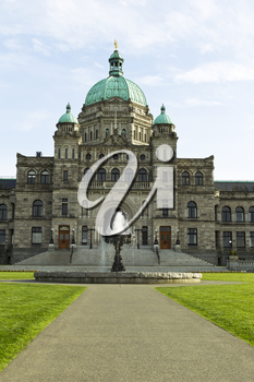 Front of capital building in Victoria Canada with water fountain along with blue sky and clouds in background