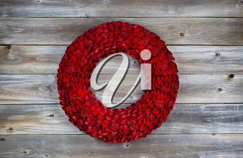 Wooden Red holiday wreath on rustic wood