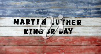 Martin Luther King JR Day large text letters on red, white and blue wooden boards