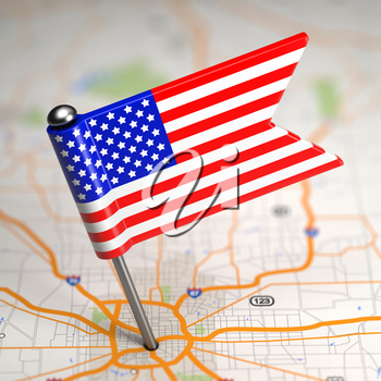 Small Flag of United States of America on a Map Background with Selective Focus.