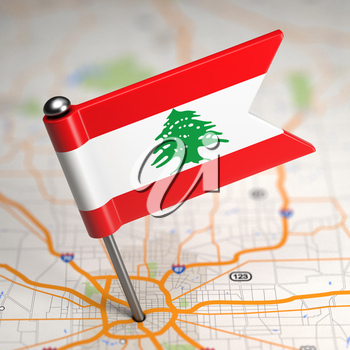 Small Flag of Lebanon on a Map Background with Selective Focus.