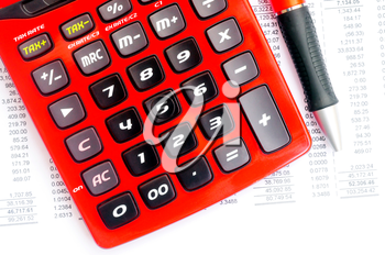 Royalty Free Photo of a Red Calculator and Pen