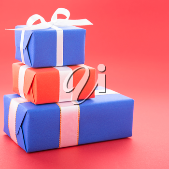 Gift boxes with a bows, isolated on red background