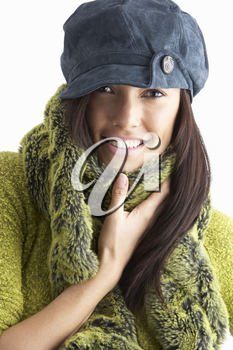Fashionable Young WomanWearing Cap And Knitwear In Studio