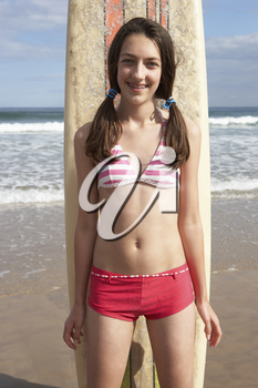 Teenager girl with surf