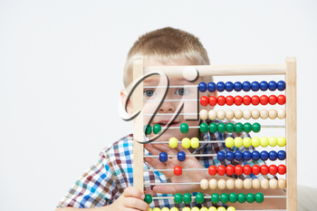 Studio Shot Of Boy Playing With Abacus
