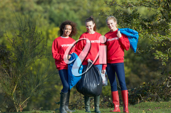 Group Of Female Volunteers Collecting Litter