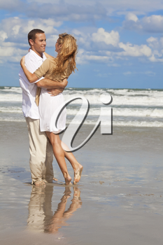 A young man and woman having fun as a romantic couple on a beach