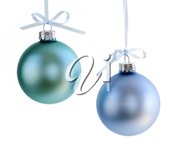 Two Christmas decorations hanging isolated on white