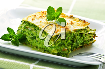 Serving of fresh baked vegeterian spinach lasagna on a plate