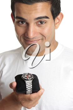 A smiling man holding a chronograph wrist watch with metal bracelet.  White background.