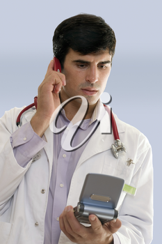 Male hospital worker or doctor talking on a mobile phone