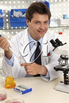 Friendly cheerful research scientist, chemist or medical technician in laboratory.