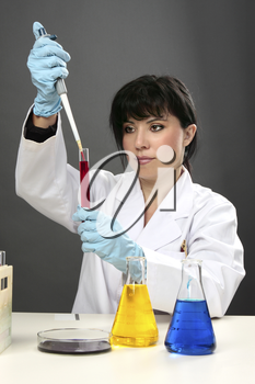 A scientific researcher conducting research, developing a cure or testing for disease or other substances in a laboratory.