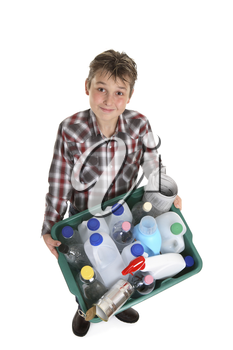 Boy carrying a recycling container full of empty bottles, cans, etc suitable for recycling.