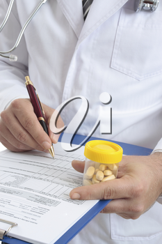 A medical healthcare  doctor with  health records and medicine.  Focus to hand with pills