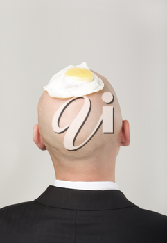 Rear view of male�s bald head with fried eggs on it
