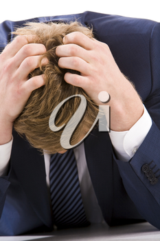 Portrait of tired businessman touching his head