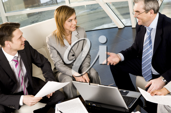 Portrait of friendly workteam communicating with each other in office at meeting