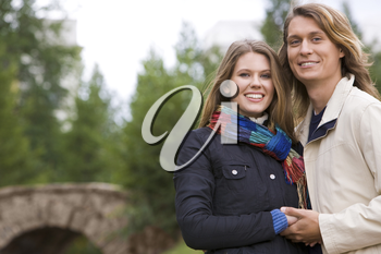 Portrait of affectionate couple smiling and looking at camera