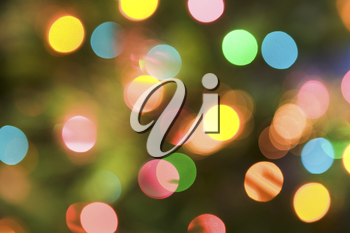 Glittering Christmas background with red, blue, yellow and green spangles