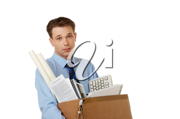 Portrait of businessman holding box with documents and other things