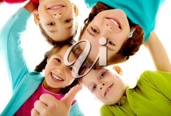 Photo of joyful children touching by their heads with girl her thumb up