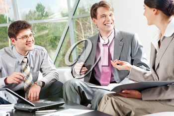 Image of business group discussing a their work