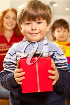 Portrait of happy child holding red gift box