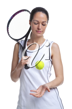Woman tennis player throwing the ball up in the air, isolated on a white background.