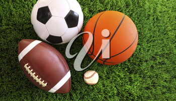 Royalty Free Photo of an Assortment of Sports Balls on Grass
