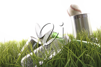 Royalty Free Photo of Empty Cans, a Water Bottle and Baseball in the Grass