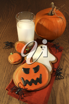 Royalty Free Photo of Halloween Cookies and a Glass of Milk
