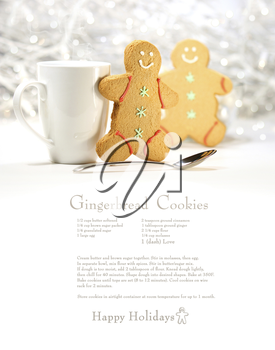 Royalty Free Photo of a Gingerbread Cookie Recipe with Two Cookies and a Cup