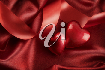 Royalty Free Photo of Two Red Hearts on Satin