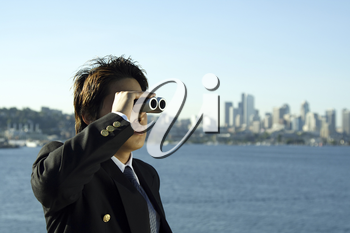 Businessman looking through binoculars, can be used for vision/prospects metaphor