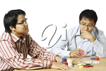 An isolated shot of two young men playing poker
