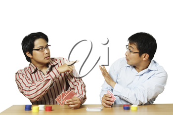 An isolated shot of two men playing poker with one of them get caught for cheating