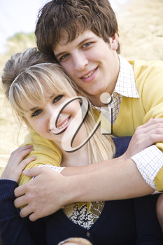 A portrait of a beautiful young caucasian couple in love outdoor