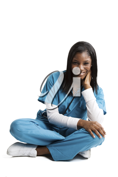 An isolated shot of an african american nurse in sitting position