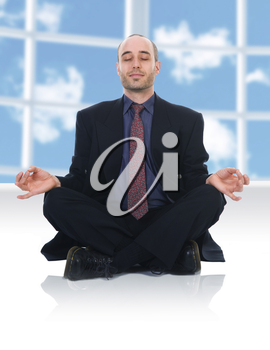business man in a meditation position on white