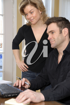 couple at home on the laptop on the table