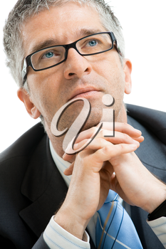 Closeup portrait of tired businessman leaning on his hands, looking up. Isolated on white background.