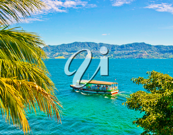 Boat on Lake Toba in Sumatra, Indonesia. It is the largest and deepest volcanic crater lake in the world.