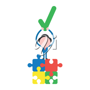 Vector illustration businessman character standing on four connected jigsaw puzzle pieces and holding up check mark.