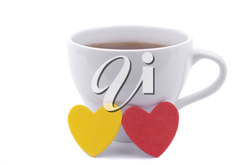 Cup of coffee and two hearts on a white background.