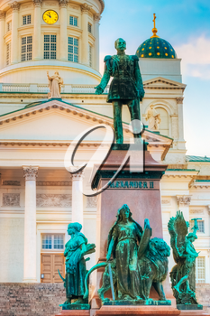 Statue Of Emperor Alexander II Of Russia Before The Helsinki Cathedral Background