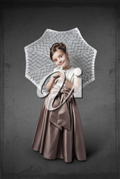 Girl in a luxurious dress with an umbrella