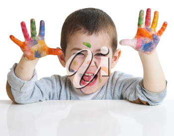 happy little boy with paints on hands isolated on white background